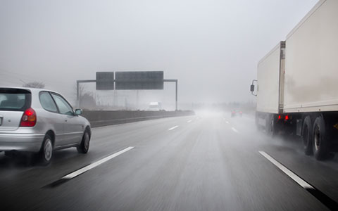Cars driving in rain and wind