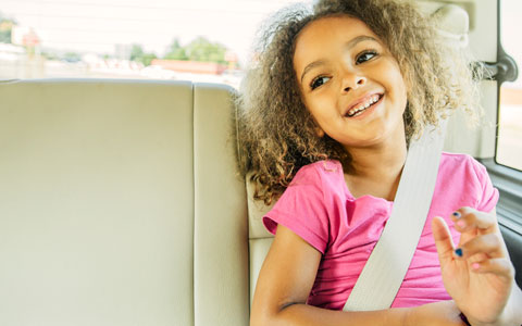 Child in back seat with seat belt on