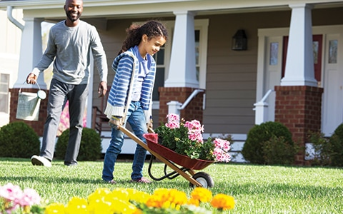 man and daughter gardening outside, 7 family activities you can do while you're working from home