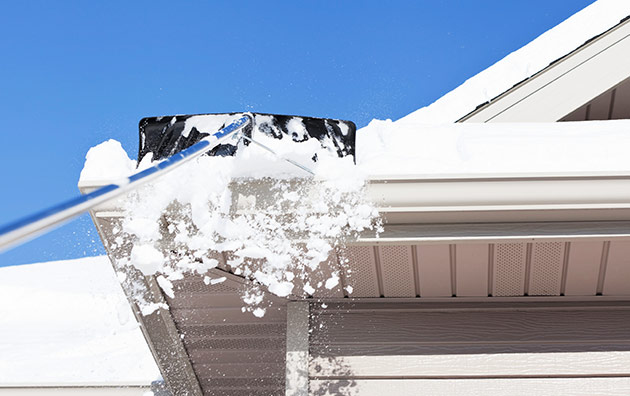 removing snow from roof