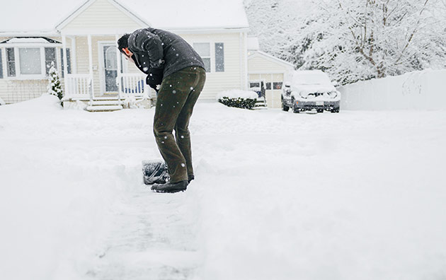 Person shoveling their driveway after a snow storm