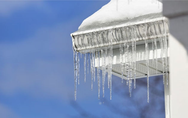 Ice dam formed on roof of house