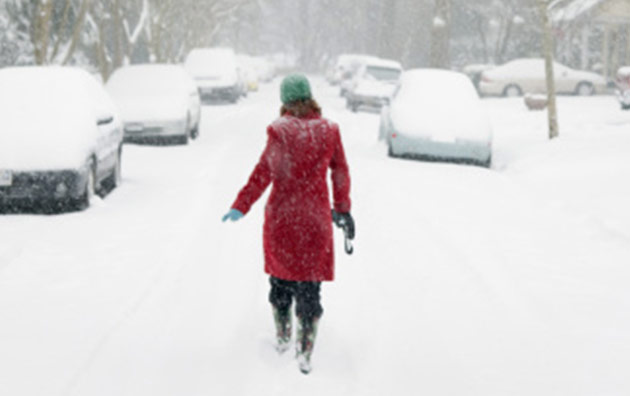 woman walking in snow storm