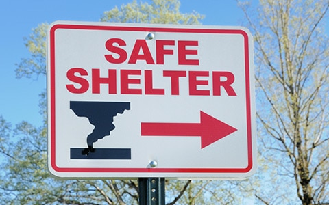 Seek shelter sign for what to do in a tornado