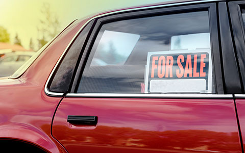 for sale sign on a used car