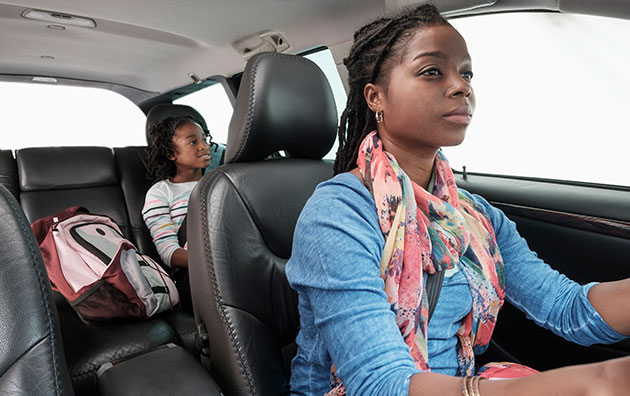 mother safely driving daughter
