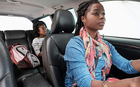 Mother driving safely with child in the backseat
