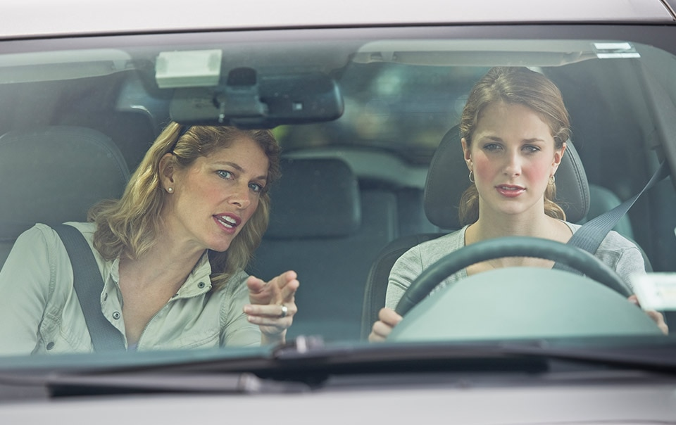 Mom driving with teen in insured car