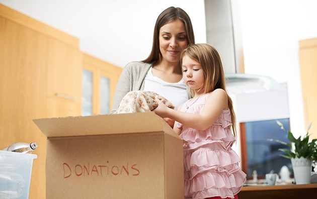Woman packing boxes with daughter