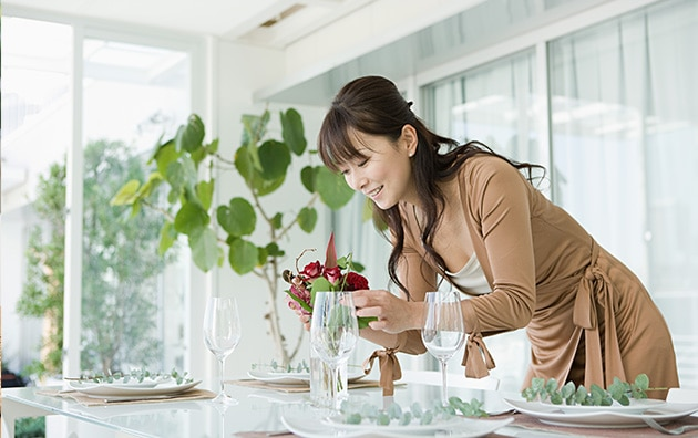 Woman staging dining room table for open house