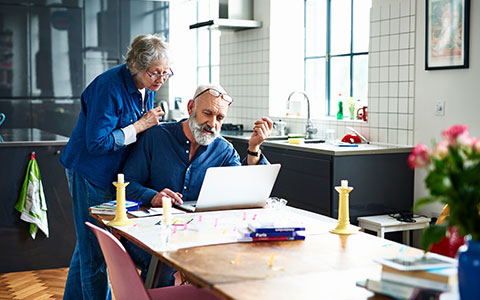 older couple researching what to know before buying second home