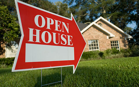 Open house sign in front of house