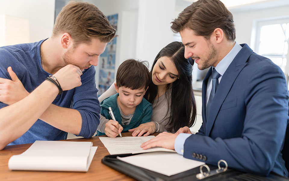 Family meeting with real estate agent to buy new home