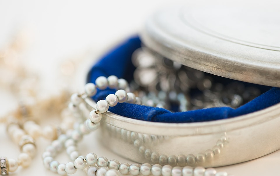Pearls in a jewelry box covered in valuable items insurance coverage