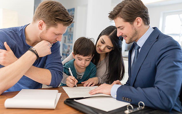 Family signing contract for new home