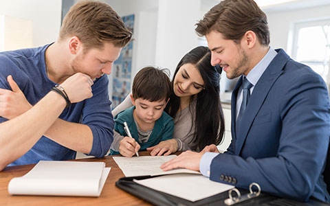 Family meeting with real estate agent buying new home