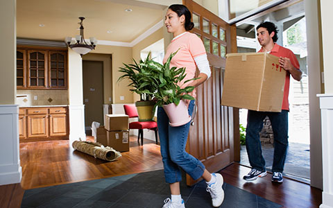 Couple moving stuff from apartment into new home