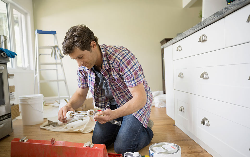 Person working on home improvement project in kitchen