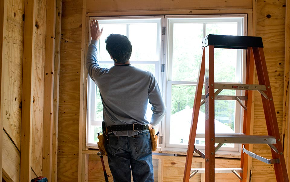 person working on installing new window in house