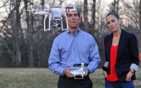 Stephanie Duchaine and home inspector Brian O'Rear flying drone