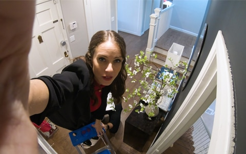 Stephanie Duchaine adjusted smart tech in front of CNET Smart Home front door