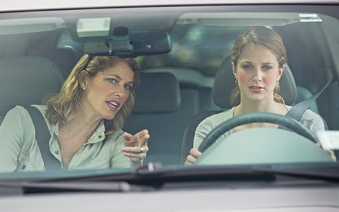 mother driving with daughter in insured car